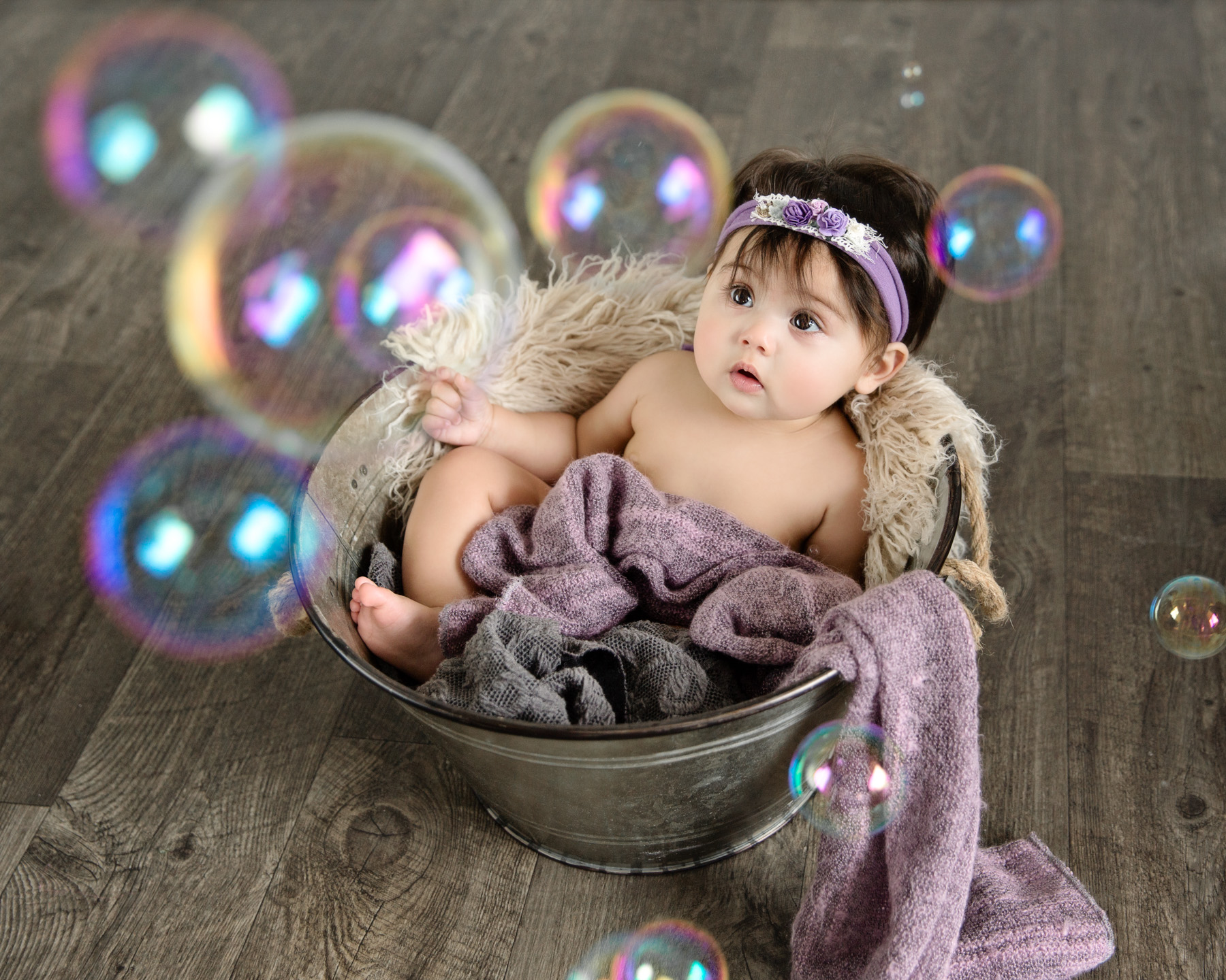 6 month old girl looking at bubbles