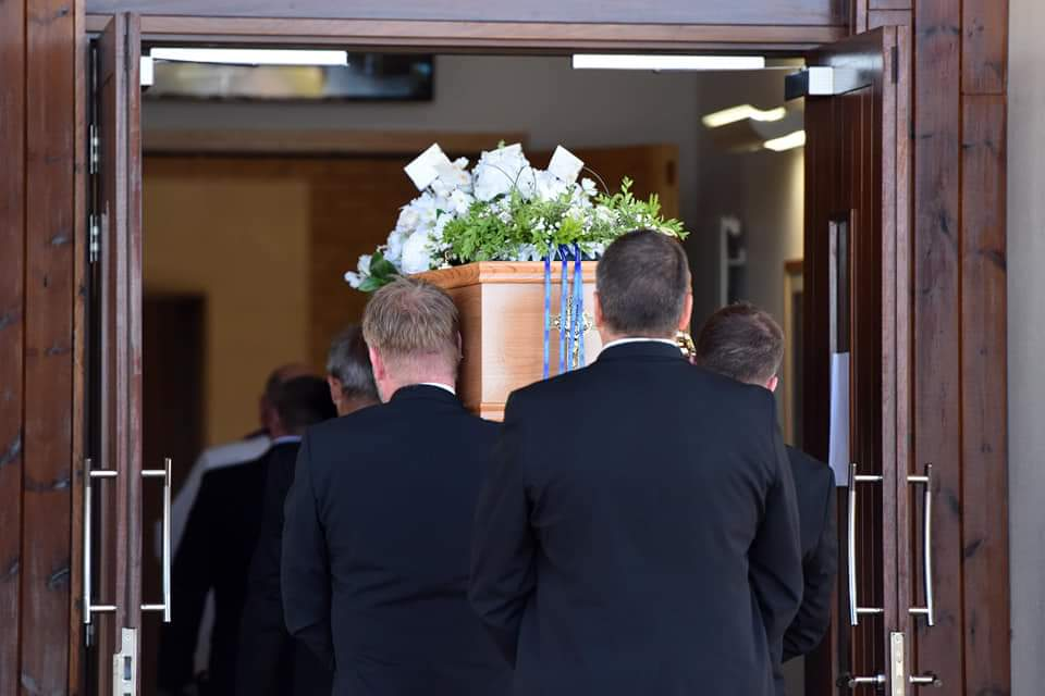 Jackson Family Funeral Directors traditionally shouldering a coffin